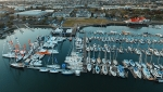 An aerial view shows the reconfigured dock at a local boat show full with big boats