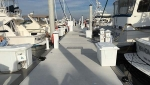 The concrete docks at Tampa YC are trimmed out with a gray composite material