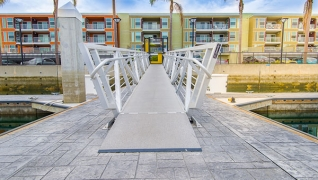 The marina gangway at this marina features a unique tipped a handrail