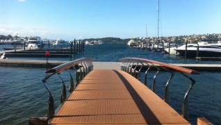 A teak gangway greets boaters as they walk onto the marina's docks